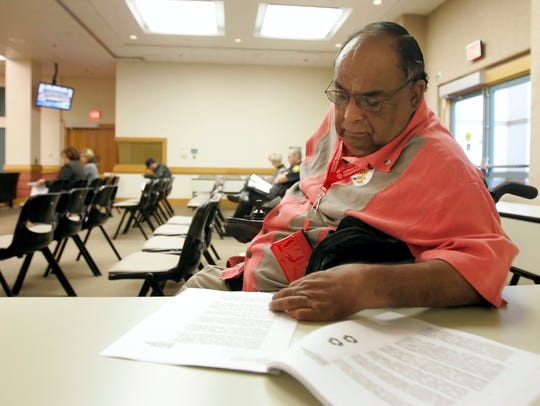 Abel Alonzo, seen here looking over the agenda as members