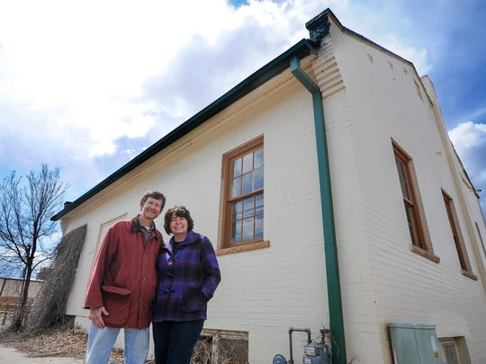 Jeff and Kathleen Baumgardner stand in front of the building that will soon become FoCo Café. The restaurant is based on a pay-what-you-can model, relying on volunteers to cook and serve the food. They hope to build community by providing nutritious meals to people in Fort Collins regardless of their ability to pay.