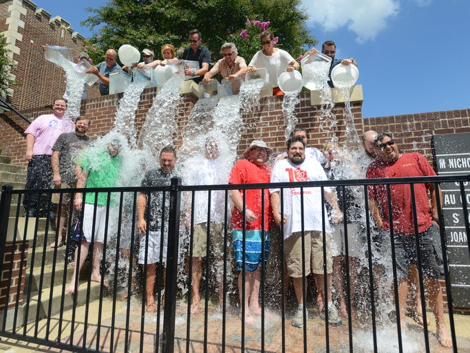 A group of Jackson-area chefs takes the Ice Bucket Challenge outside Duling Hall in Fondren on Thursday.  The group called out their own challenge to chefs John Folse and Nick Tramonto who will soon open Seafood R'evolution in Ridgeland.