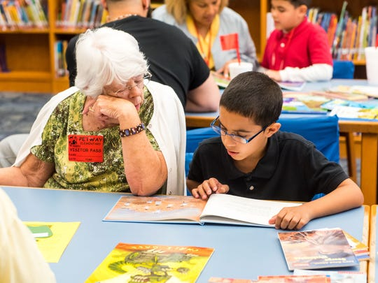 Grandparents read to grandkids as part of an annual