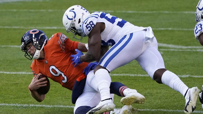 Chicago Bears quarterback Nick Foles is tackled by Indianapolis Colts' Bobby Okereke, Sunday, Oct. 4, 2020, in Chicago.