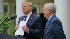 President Trump picks up his notes after he and Senate