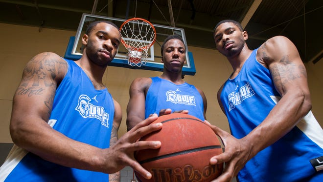 Argonaut basketball players Rashaan Benson (11), left to right, Darryl Tucker (21), and Marvin Jones (4) pose at the University of West Florida in Pensacola on Wednesday, March 7, 2018.