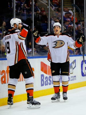 Anaheim Ducks center Rickard Rakell (67) celebrates a goal scored by Ducks' Patrick Maroon (19) in the first period of an NHL hockey game against the against the New York Islanders Saturday, March 28, 2015, in Uniondale, N.Y.  (AP Photo/Paul Bereswill)