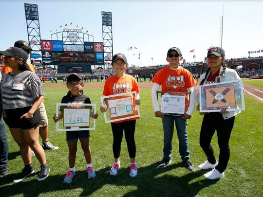 Roberto de Leon (second from right) won a contest that allowed him to go on the field during a San Francisco Giants game.
