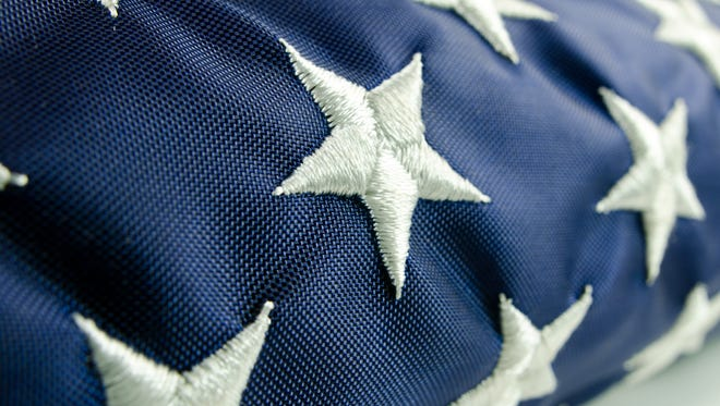An American flag close-up and folded. Stars only