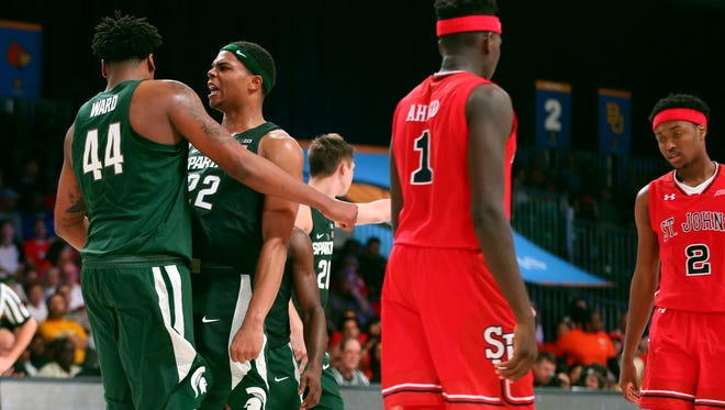 Michigan State Spartans forward Nick Ward (44) and guard Miles Bridges (22) celebrate a score in front of St. John's Red Storm guard Bashir Ahmed (1) during the second half at the Imperial Arena at the Atlantis Resort.