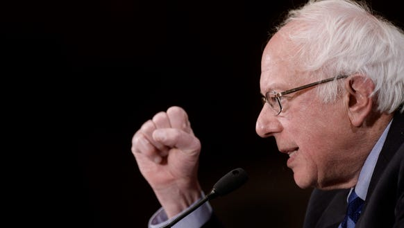 Bernie Sanders speaks during a press conference at