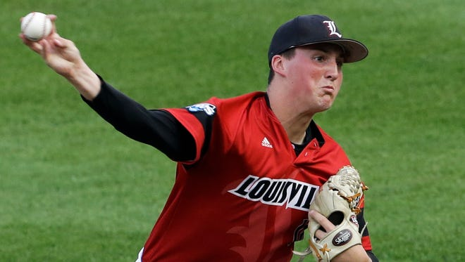 Louisville pitcher Kyle Funkhouser delivers against Vanderbilt in the first inning of an NCAA baseball College World Series game in Omaha, Neb., Saturday, June 14, 2014. (AP Photo/Nati Harnik)