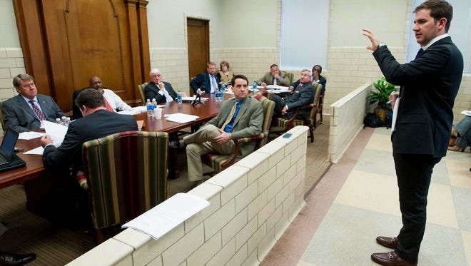 Trevor Theunissen, Public Policy Manager Uber Southeast, answers questions during a work session of the Montgomery City Council at city hall in Montgomery, Ala. on Tuesday January 5, 2016.