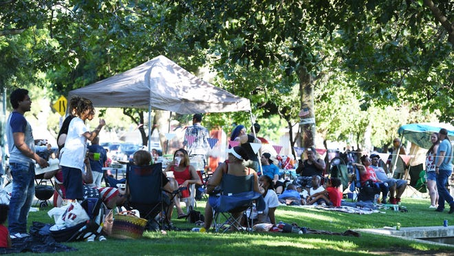 """The crowds of people choose their spots around McLeod Lake near Weber Point Events Center for Fourth of July fireworks on July 4, 2019. """"I'm really, really worried that people are going to have gatherings outside of their family members,"""" San Joaquin County Public Health Services Officer Dr. Maggie Park said Wednesday. """"That's not supposed to happen."""""""
