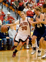 Bucyruss Kelsee Rehm, left, drives down the court against
