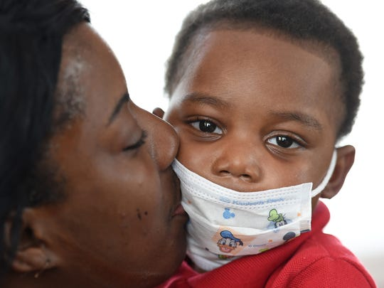 KeVon Long gets a kiss from his mother, Keshia Long,