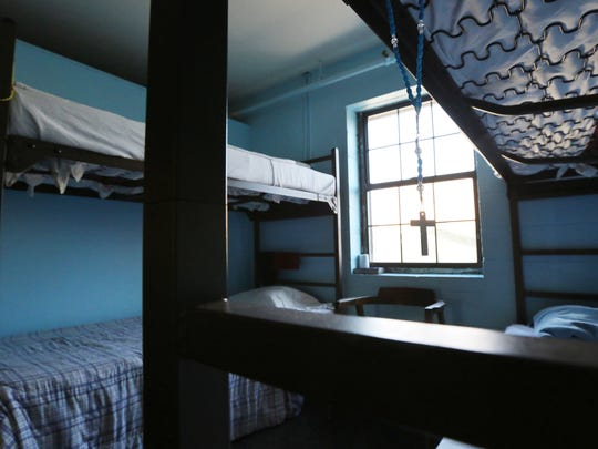 A crucifix hangs from the top bed of bunk beds on the motivational track at the Healing Place.December 15, 2015