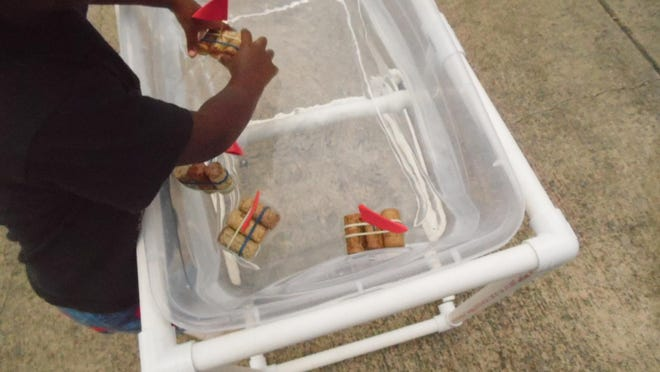 Make your own water table out of PVC piping and mini sailboats out of wine corks to float in the water.