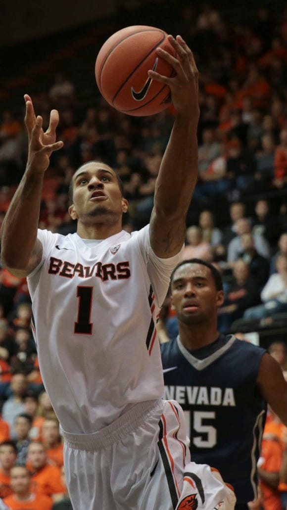 Dec 5, 2015; Corvallis, OR, USA; Oregon State Beavers guard Gary Payton II (1) shoots the ball as Nevada Wolf Pack guard D.J. Fenner (15) watches at Gill Coliseum. Mandatory Credit: Scott Olmos-USA TODAY Sports