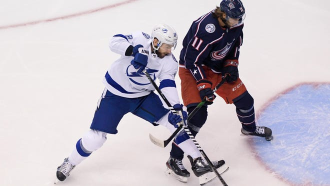 The Lightning has gotten consistent production from its third line, which includes center Barclay Goodrow, left, shown against Blue Jackets center Kevin Stenlund in Monday's game.