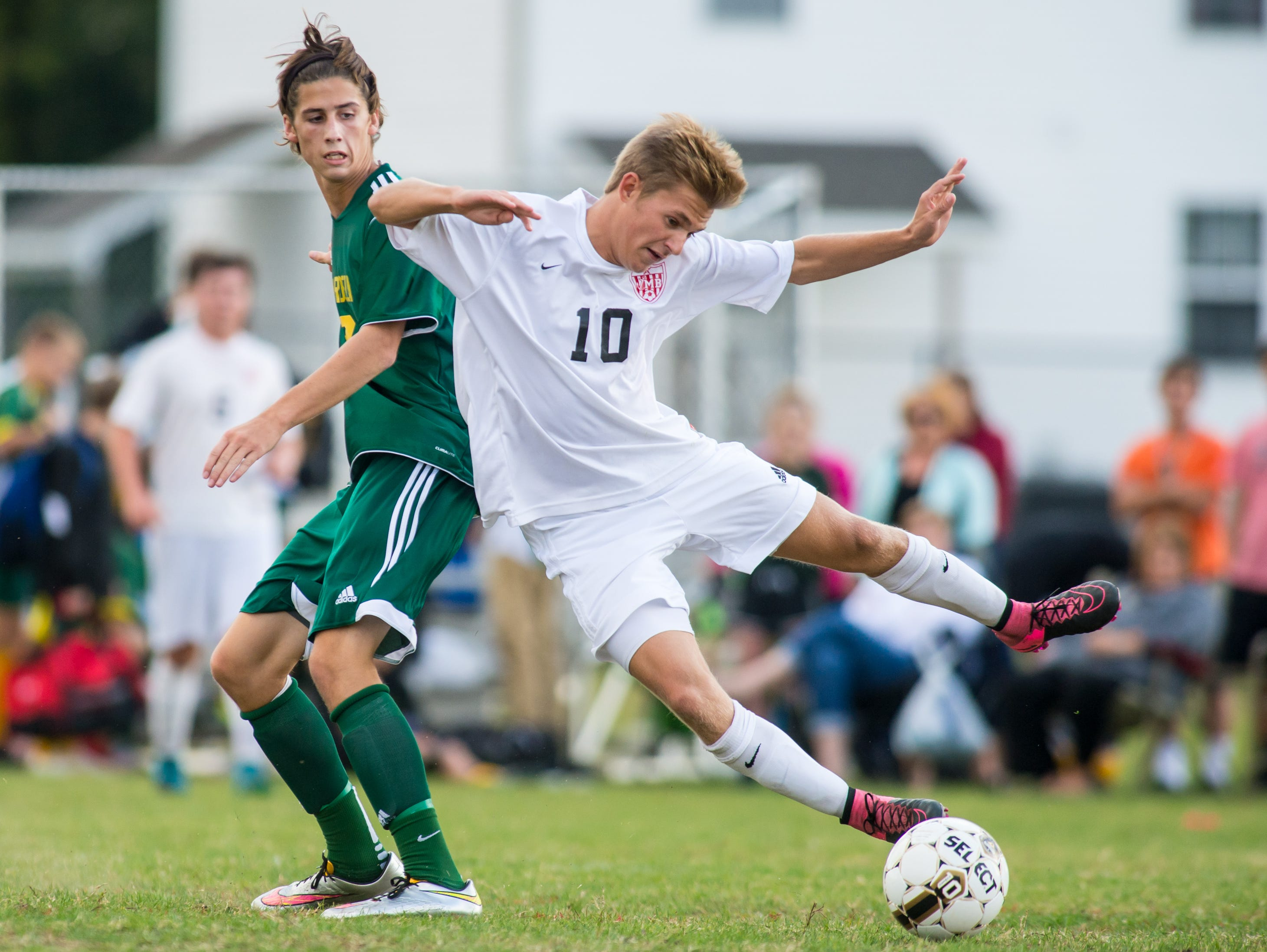 James M Bennett's Will Cooledge (10) trips against Mardela on Wednesday afternoon at James M Bennett.