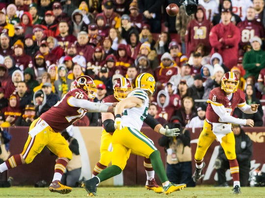 Washington quarterback Kirk Cousins (8) passes against Green Bay during the second half of the NFL Wild Card Playoff against Green Bay on Sunday, January 10th at FedEx Field in Landover, MD.