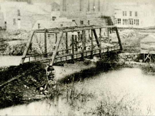 The bridge the city ever stretched across the Big Sioux River was at Eight Street in 1876. But shortly after it was finished, a flood washed it out. It was six years before it was replaced.