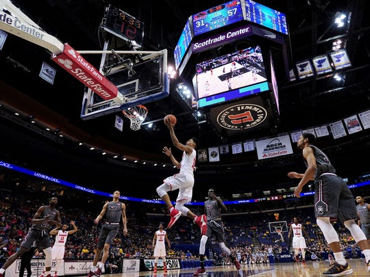 Mar 4, 2017; St. Louis, MO, USA; Illinois State Redbirds forward Phil Fayne (10) puts up a lay up against the Southern Illinois Salukis during the second half of the Missouri Valley Conference Tournament at Scottrade Center. Illinois State won 63-50.