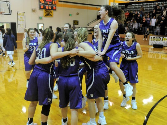 The Wylie girls basketball team celebrates following its 63-45 win against Stephenville in the Region I-4A quarterfinals in Cisco on Tuesday, Feb. 20, 2018.