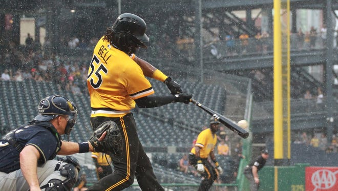 Pirates first baseman Josh Bell  hits the winning double against the Brewers during the 10th inning Sunday.