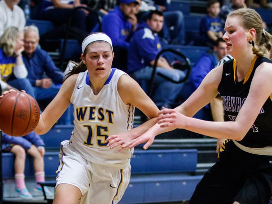 New Berlin West senior Alyssa Nelson (15) makes a run from the corner during the game at home against New Berlin Eisenhower on Tuesday, Jan. 23.
