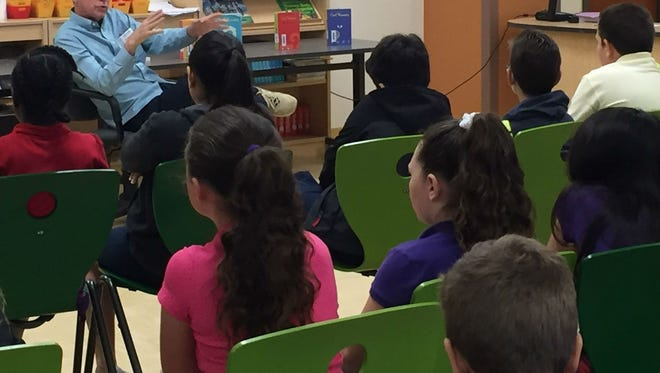 Author Carl Hiassen tells fifth-graders at Vero Beach Elementary School how he became a journalist. Hiaasen was one of several community leaders to kick off Literacy Week by reading or speaking to Indian River County students on Jan. 23, 2017.