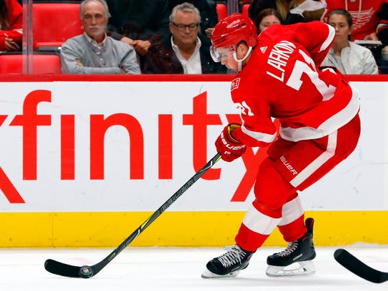 Red Wings center Dylan Larkin (71) skates with the