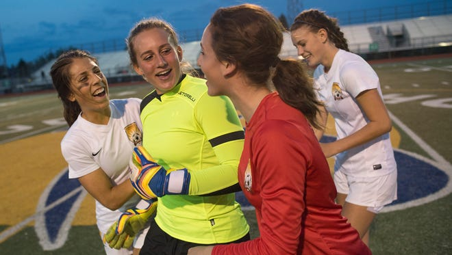 Rocky Mountain High School goalkeeper Gabriella McDonald celebrates with her teammates after a 1-0 win over Brighton at French Field.