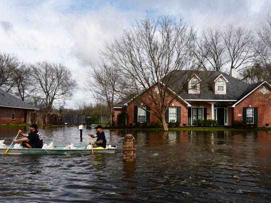 Firefighters boat into Golden Meadows subdivision to
