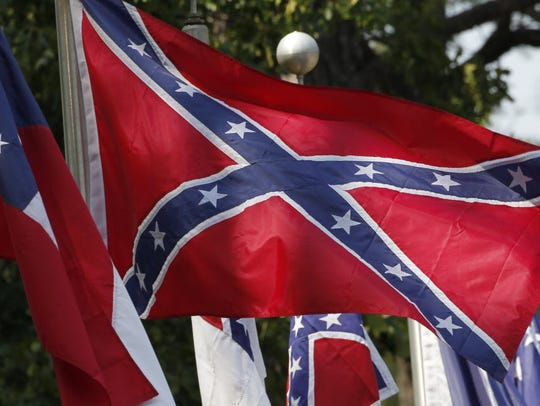 In this 2011 file photo, Confederate battle flags fly