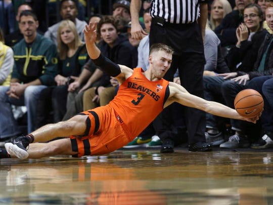 Oregon State's Tres Tinkle dives for a ball during the first half of an NCAA college basketball game against Oregon on Saturday, Jan. 27, 2018, in Eugene, Ore. (AP Photo/Chris Pietsch)
