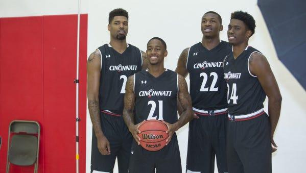 (From left:) UC seniors Octavius Ellis, Farad Cobb, Coreontae DeBerry and Shaq Thomas model the Bearcats' new Under Armour uniforms.