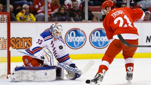 Rangers goalie Cam Talbot thwarts Red Wings forward Tomas Tatar in the first period Saturday night at Joe Louis Arena in Detroit.