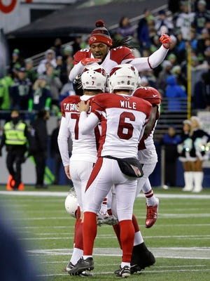 Arizona Cardinals congratulate Chandler Catanzaro (7) on his winning field goal on the final play against the Seattle Seahawks in an NFL football game, Saturday, Dec. 24, 2016, in Seattle.