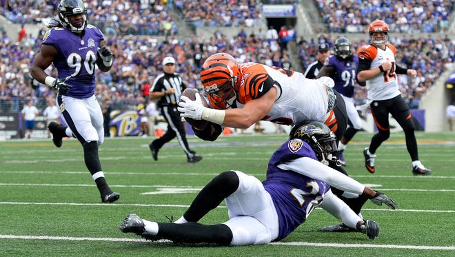 Cincinnati Bengals tight end Tyler Eifert (85) leaps over Baltimore Ravens defensive back Brynden Trawick (28) for a touchdown during the second quarter, that was reversed by the officials at M&T Bank Stadium.