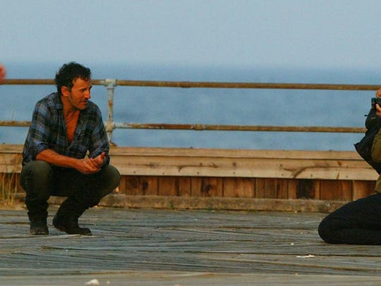 Bruce Springsteen on the boardwalk of Asbury Park in 2002, having his picture taken by a photo crew. He was just north of the carousel building/ Michael J. Treola Staff Photographer