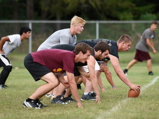 Royalton players run through their offensive plays during practice Thursday, Aug. 18, in Royalton.