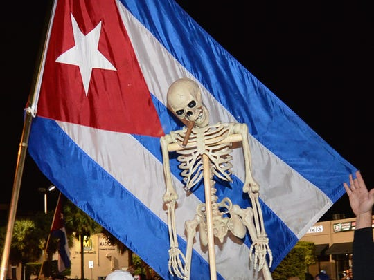 Miami residents celebrate the death of Fidel Castro on Saturday in Miami. Cuba's current president and younger brother of Fidel, Raul Castro, announced in a brief TV appearance that Fidel Castro had died at 90.