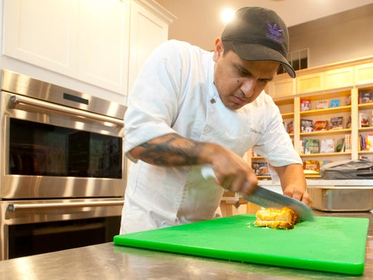 Chef Paco Garcia slices up bread for Mexican bread pudding. Feb. 19, 2018