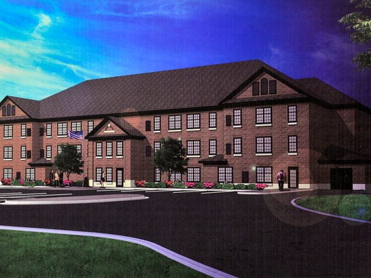 An artist's rendering shows the proposed housing project.