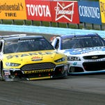 Spirited racing between the Sprint Cup cars driven by Marcos Ambrose (left) and winner AJ Allmendinger through the high-speed Esses at Watkins Glen International made for another exciting Cheez-It 355 at The Glen race in August.
