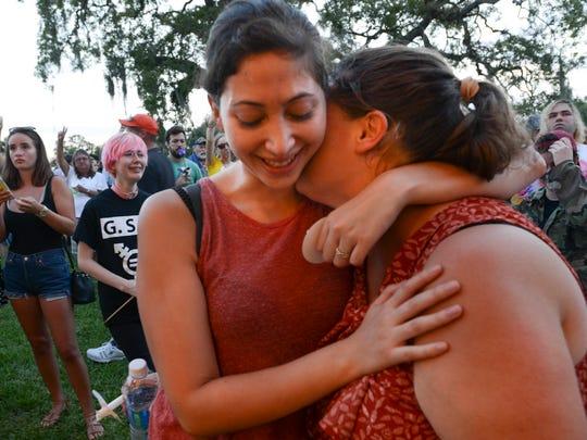 Belen and Erin Torres of Viera hug during Friday's
