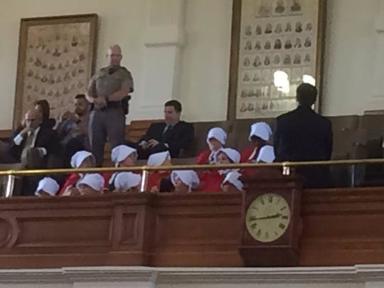 """Women dressed in """"Handmaid's Tale"""" garb in the Texas Senate gallery on March 20, 2017, to oppose legislation restricting abortion."""