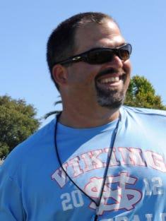 File: Steve Zenk coaching football at North Salinas High School in 2014.