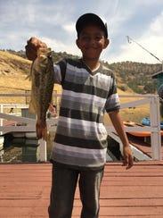 Samuel Gomez Junior caught a tagged $100 bass.