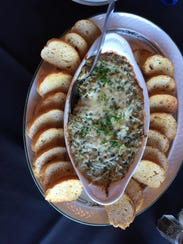 The spinach and artichoke dip appetizer.