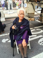 Eloise Harris, 90, looks stylish waiting in the security